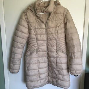 Beige women's synthetic jacket with hood.